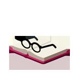 Lunettes déposées sur un livre ouvert